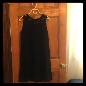 Black dress with lace neckline